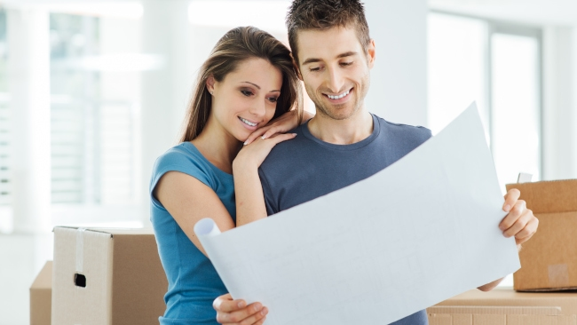 Couple-Looking-At-Plans-From-Remodeling-Contractor